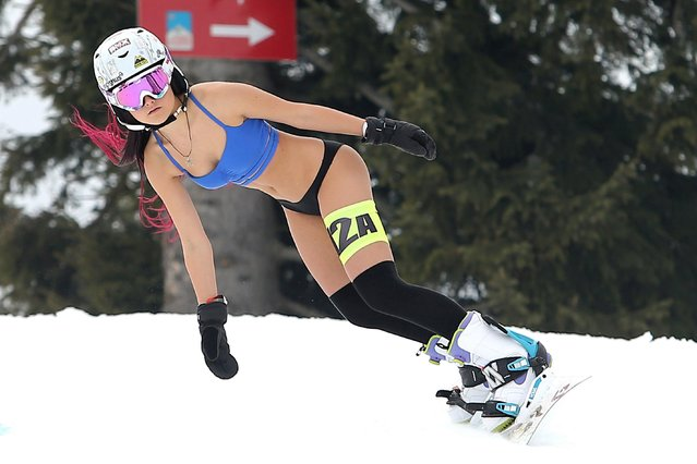 Participant Andreea Teodorescu, 17, races on a snowboard during the Bikini Race contest held at Arena Platos Paltinis winter resort, near Sibiu city, 275 km north from Bucharest, Romania, 04 March 2018. The Bikini Race is a timed show on the slopes, at the sixth edition, for women dressed only in swimmsuits and some winter accessories. (Photo by Mircea Rosca/EPA/EFE)
