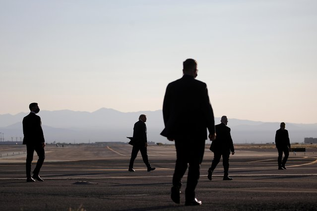 U.S. President Donald Trump walks towards Air Force One after his campaign rally at Tucson International Airport in Tucson, Arizona, U.S., October 19, 2020. (Photo by Carlos Barria/Reuters)