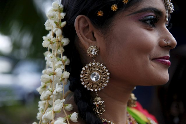 A dancer poses for a photograph before a Diwali performance in Kuala Lumpur, Malaysia, October 28, 2015. (Photo by Olivia Harris/Reuters)