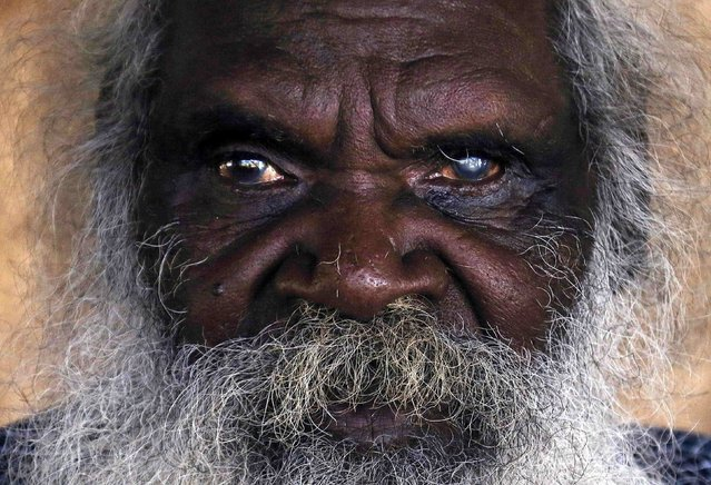 Seventy-six-year-old Australian Aboriginal elder Jimmy Burnyila of the Yolngu people sits at his house located on the outskirts of the community of Ramingining located in East Arnhem Land November 21, 2014. (Photo by David Gray/Reuters)