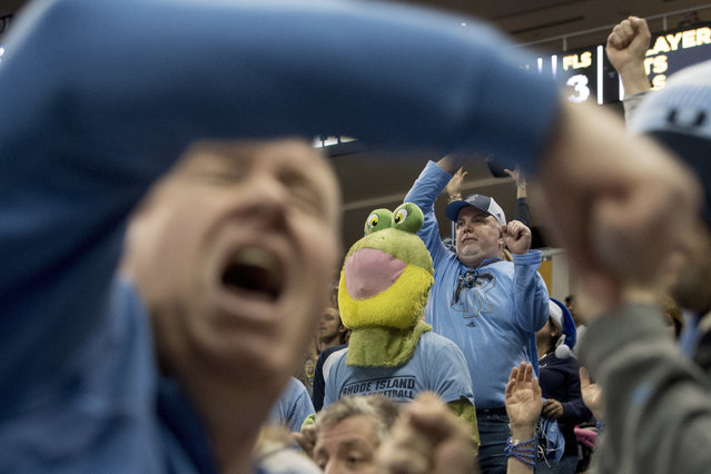 Rhode Island fans celebrate a basket against Oklahoma during an NCAA men's college basketball tournament first-round game, Thursday, March 15, 2018, in Pittsburgh. (SPhoto by teph Chambers/Post-Gazette via AP Photo)