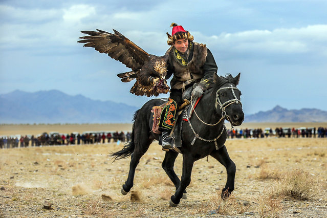 """""""It is so unique because the culture to hunt with trained birds"""". (Photo by Batzaya Choijiljav/Caters News)"""