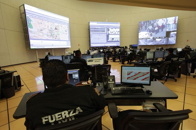 Surveillance cameras are monitored by members of the Fuerza Civil (Civil Force) police unit during a media presentation to show the police model that the federal government wants for the rest of the country, at the police academy in Monterrey December 17, 2014. (Photo by Daniel Becerril/Reuters)
