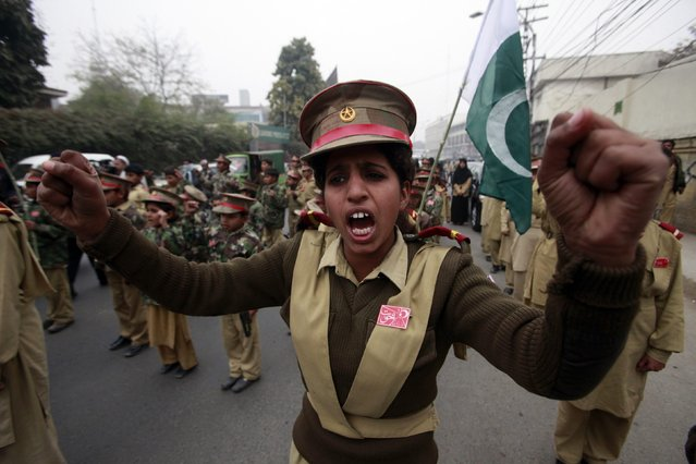 A female student chants slogans with others to condemn the attack by Taliban gunmen on the Army Public School in Peshawar, during a rally in Lahore December 19, 2014. At least 132 students and nine staff members were killed on Tuesday when Taliban gunmen broke into the school and opened fire, witnesses said, in the bloodiest massacre the country has seen for years. (Photo by Mohsin Raza/Reuters)