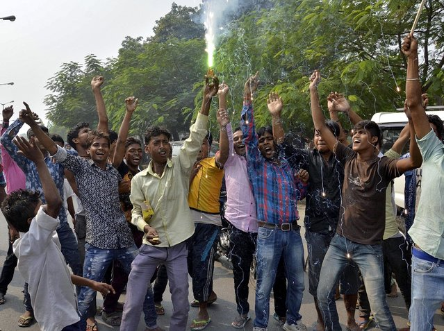Supporters of Janata Dal (United) and Rashtriya Janata Dal celebrate after learning of initial election results on a street in Patna, India, November 8, 2015. Prime Minister Narendra Modi was heading for defeat on Sunday in a key election in India's big state of Bihar, signaling the waning power of a leader who until recently had an unrivaled reputation as a vote winner.  (Photo by Reuters/Stringer)