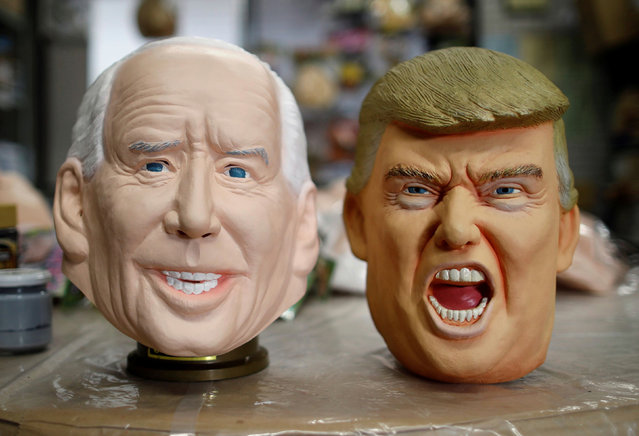 Masks depicting U.S. President-elect Joe Biden and President Donald Trump are displayed at Ogawa Studios, a mask and toy making company, in Saitama, Japan on November 12, 2020. (Photo by Issei Kato/Reuters)