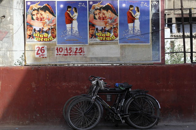 Posters for a low budget Hindi film are pasted onto the wall of a cinema in Meerut in the northern Indian state of Uttar Pradesh April 28, 2013. (Photo by Danish Siddiqui/Reuters)
