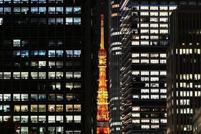 The Tokyo Tower is seen at night in the Japanese capital on December 14, 2020. (Photo by Charly Triballeau/AFP Photo)