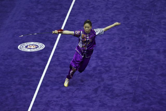 Korea's Je Ga-yeong competes in the women's jianshu final during the 13th World Wushu Championship 2015 at Istora Senayan stadium in Jakarta, November 17, 2015. (Photo by Reuters/Beawiharta)
