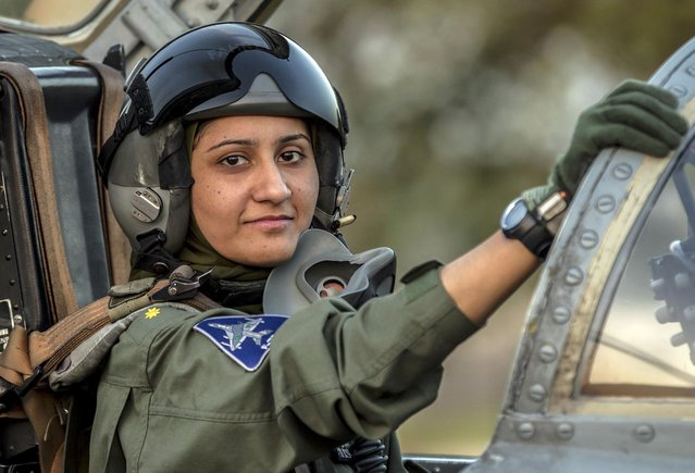 Ayesha Farooq, 26, Pakistan's only female war-ready fighter pilot, poses for photograph as she sits in the cockpit of a Chinese-made F-7PG fighter jet at Mushaf base in Sargodha, north Pakistan June 6, 2013