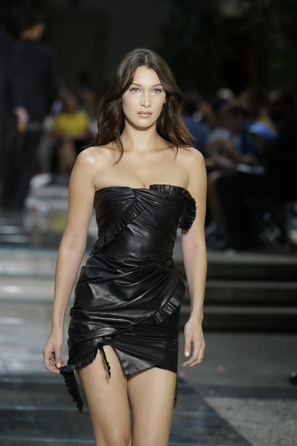 Model Bella Hadid wears a creation as part of Versace's men's 2019 Spring-Summer collection, unveiled during the Fashion Week in Milan, Italy, Saturday, June 16, 2018. (Photo by Luca Bruno/AP Photo)