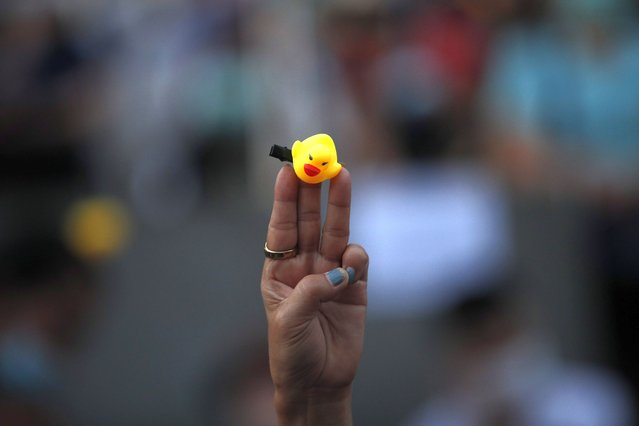 A Thai anti-government protester flashes a three-finger salute with a rubber-duck during a street protest calling for political and monarchical reform in Bangkok, Thailand, 28 November 2020. Thailand has been facing political turmoil amid months-long street protests calling for the political and monarchical reform and the resignation of the prime minister Prayuth Chan-ocha. (Photo by Rungroj Yongrit/EPA/EFE)