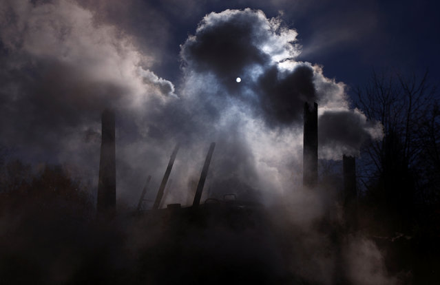 Smoke rises from chimneys of a charcoal furnace at a charcoal making site in the forest of Bieszczady Mountains, near the village of Baligrod, Poland October 28, 2016. (Photo by Kacper Pempel/Reuters)