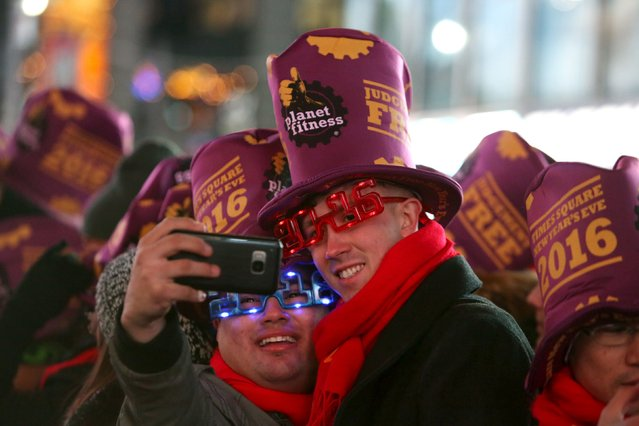 People take a selfie during New Year celebrations in Times Square in the Manhattan borough of New York December 31, 2015. (Photo by Andrew Kelly/Reuters)