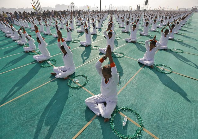 School children attend a yoga session on the last day of the 10-day long camp in Ahmedabad, India, January 10, 2016. (Photo by Amit Dave/Reuters)