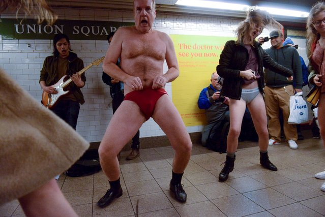 People with no pants dance at the Union Square subway station during the annual No Pants Subway Ride in New York, January 10, 2016. (Photo by Stephanie Keith/Reuters)