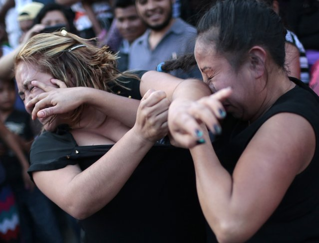 Two women hit each other in a fight representing the Xochimilcas fight to defend their women against the Aztecs in the municipality of Zitlala in Guerrero district on February 17, 2015. Fighting plays an important role in some of the traditions for the indigenous groups in Guerrero. (Photo by Pedro Pardo/AFP Photo)