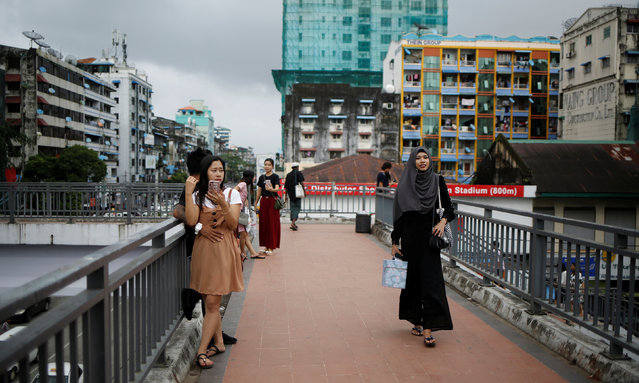 Blogger Win Lae Phyu Sin, 19, walks home after teaching a class in downtown Yangon, Myanmar, August 12, 2018. (Photo by Ann Wang/Reuters)
