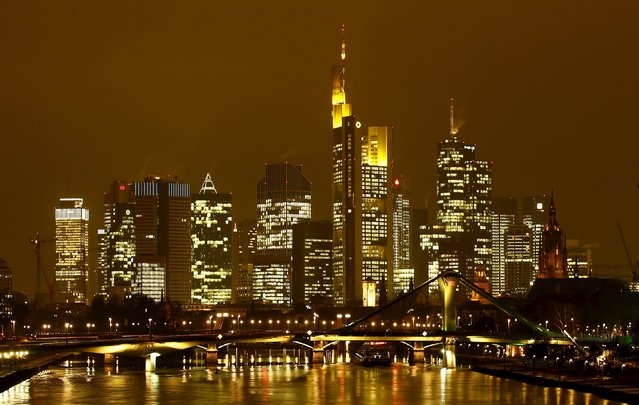The famous skyline with its banking district is pictured in early evening next to the Main River in Frankfurt, Germany, January 19, 2016. (Photo by Kai Pfaffenbach/Reuters)