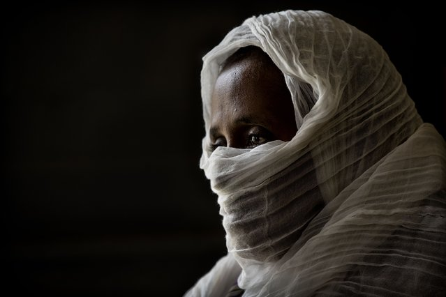 """A 40-year-old woman who was says she was held captive and repeatedly raped by 15 Eritrean soldiers over a period of a week in a remote village near the Eritrea border, speaks during an interview at a hospital in Mekele, in the Tigray region of northern Ethiopia, on Friday, May 14, 2021. """"They talked to each other. Some of them: 'We kill her.' Some of them: 'No, no. Rape is enough for her'"""", she recalls. She said one of the soldiers told her: """"This season is our season, not your season. This is the time for us"""". (Photo by Ben Curtis/AP Photo)"""
