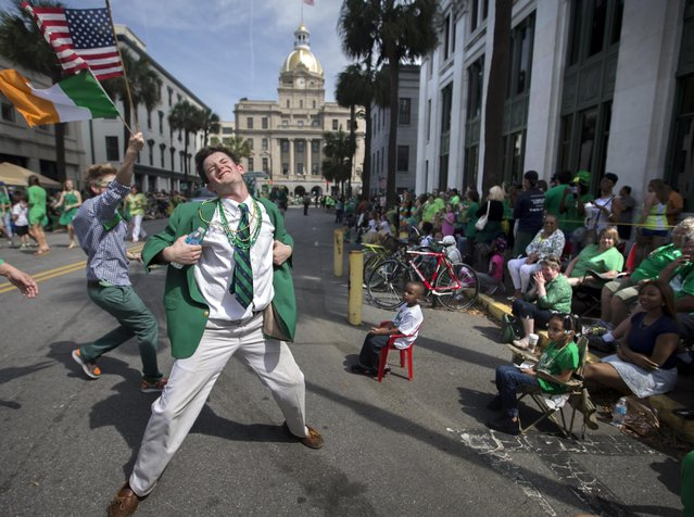 Lamar Lester III dances while marching with the Doherty Clan during the 191st St. Patrick's Day parade, Tuesday, March 17, 2015, in Savannah, Ga. (Photo by Stephen B. Morton/AP Photo)