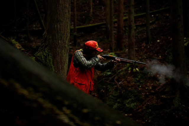 Hunter Chiaki Kodama shoots a deer in a forest outside Oi, Fukui Prefecture, Japan, November 17, 2016. (Photo by Thomas Peter/Reuters)
