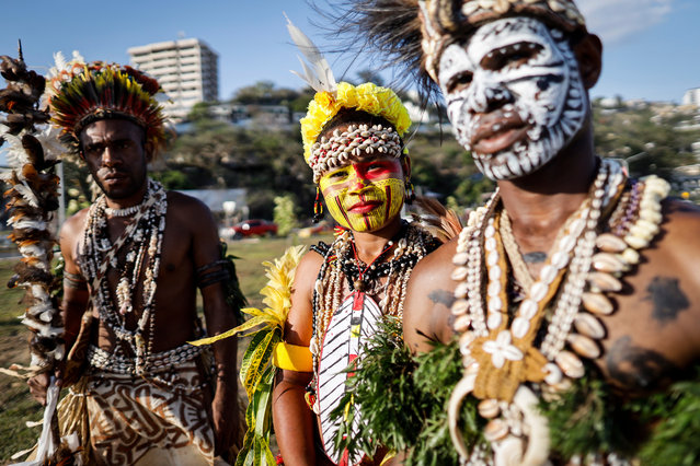 Traditional dancers are seen at Ela Beach, near a venue of the Asia-Pacific Economic Cooperation (APEC) summit in Port Moresby, Papua New Guinea, 13 November 2018. The APEC summit brings together world leaders from its 21 member nations and is being hosted for the first time by Papua New Guinea. (Photo by Mast Irham/EPA/EFE)