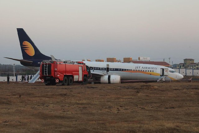 This handout photograph taken and received on December 27, 2016 from the Indian Ministry of Defence shows a damaged Jet Airways Boeing 737 after it skidded off the runway following an aborted take- off at the Goa Airport in Dabolim, India' s western resort state of Goa. An Indian plane carrying 161 passengers and crew skidded off the runway at Goa airport early on December 27, injuring 15 people. The Indian Navy, which runs the airport in western India, said it was not yet clear what caused the Jet Airways plane to veer off the runway. (Photo by AFP Photo/Indian Ministry of Defence)