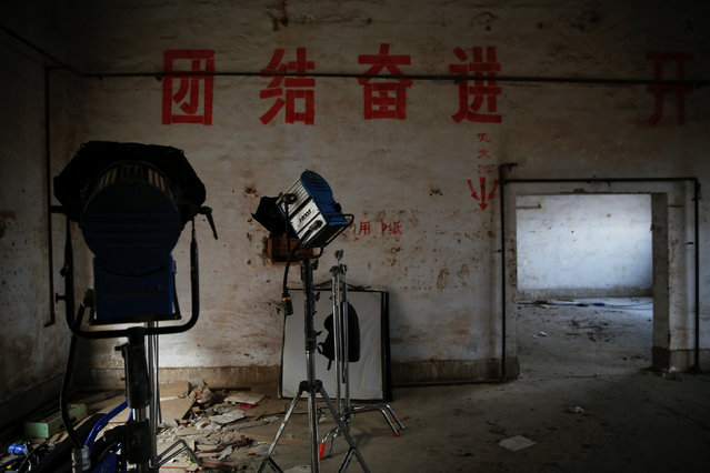 Lights are seen at the set of the post-apocalyptic movie Zombie Era at an abandoned factory complex in Langfang, Hebei province, China December 16, 2016. (Photo by Damir Sagolj/Reuters)