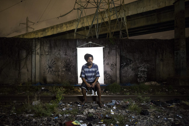 "In this March 18, 2015 photo, Douglas Wallace, 26, poses for a portrait in an open-air crack cocaine market, known as a ""cracolandia"" or crackland, where users can buy crack, and smoke it in plain sight, day or night, in Rio de Janeiro, Brazil. Collectively, the estimated 1 million crack users in Brazil are a frightening blight that's deeply troubling to government officials, whose programs have done little to halt the drug's march across the nation. Some recent studies have shown that Brazil now consumes more crack than any other country. (Photo by Felipe Dana/AP Photo)"