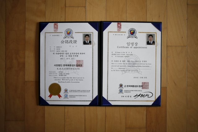 A certificate belonging to Jeong Cha-woong, a high school student who died in the Sewol ferry disaster, is seen in his room in Ansan April 8, 2015. He received the certificate from the Haedong Kendo association after he died in the disaster. His dream was to be a Haedong Kendo master. (Photo by Kim Hong-Ji/Reuters)
