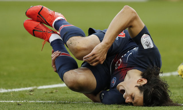 PSG's Edinson Cavani reacts as he falls during the French League One soccer match between Paris Saint-Germain and Bordeaux at the Parc des Princes stadium in Paris, Saturday, February 9, 2019. (Photo by Christophe Ena/AP Photo)