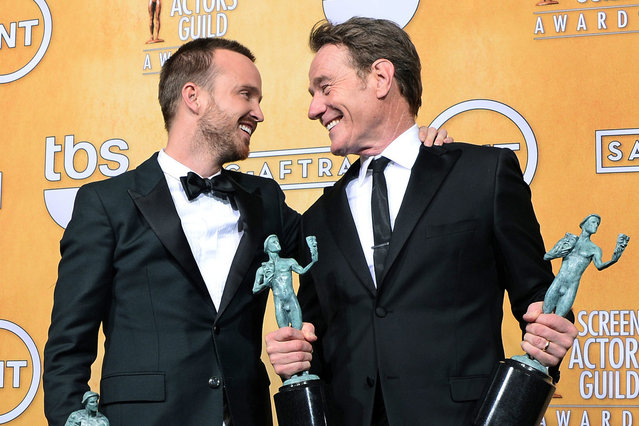 """US actors Bryan Cranston (R) and Aaron Paul  (C) hold their awards at the 20th Annual Screen Actors Guild Awards at the Shrine Auditorium in Los Angeles, California, USA, 18 January 2014. Cranston won the award for """"Outstanding Performance by an Actor in a Drama Series"""" and for """"Outstanding Performance by an Ensemble in a Drama Series"""" both for """"Breaking Bad"""". (Photo by Paul Buck/EPA)"""