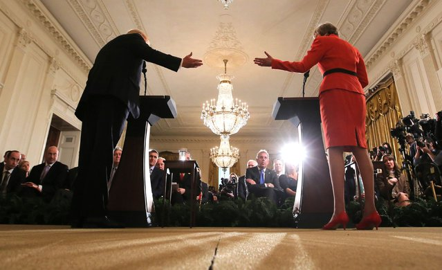 U.S. President Donald Trump and British Prime Minister Theresa May gesture at one another as they hold a joint news conference at the White House in Washington, U.S., January 27, 2017. (Photo by Carlos Barria/Reuters)