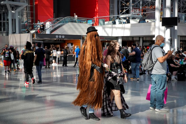 People attend in costume the 2021 New York Comic Con, at the Jacob Javits Convention Center in Manhattan in New York City, New York, U.S., October 7, 2021. (Photo by Brendan McDermid/Reuters)