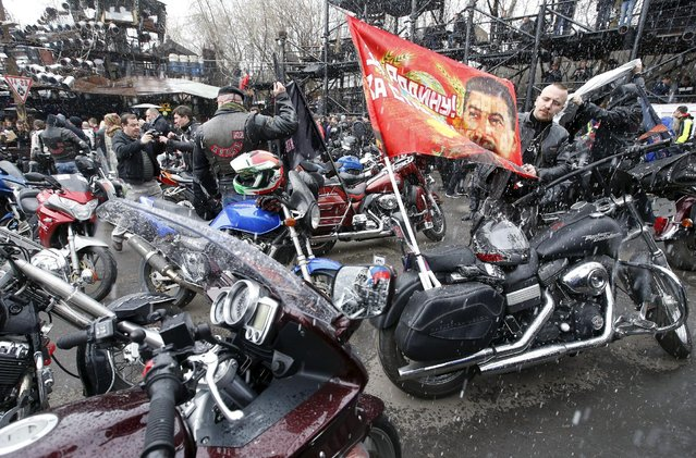 A man adjusts a flag before a farewell ceremony to see off participants of a bike ride, commemorating the 70th anniversary of the victory over Nazi Germany in World War Two, at a bike centre in Moscow, April 25, 2015. Poland will not allow members of a Russian motorcycle club linked to President Vladimir Putin to cross its border and enter the European Union's territory, the Polish Foreign Ministry said on Friday, in a decision Moscow said was politically motivated. (Photo by Sergei Karpukhin/Reuters)