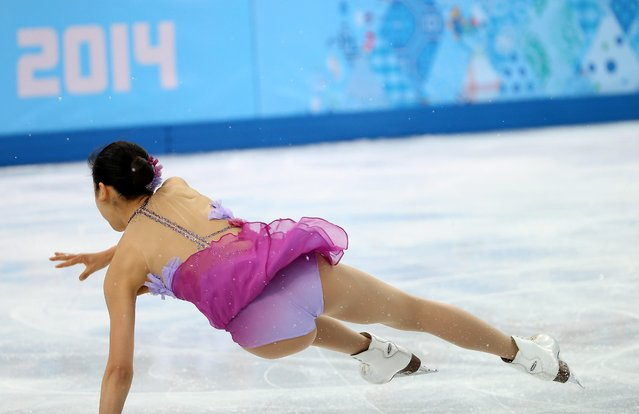 Mao Asada of Japan falls during the women's Short Programme of the Figure Skating team event at Iceberg Skating Palace during the Sochi 2014 Olympic Games, Sochi, Russia, 08 February 2014. (Photo by How Hwee Young/EPA)