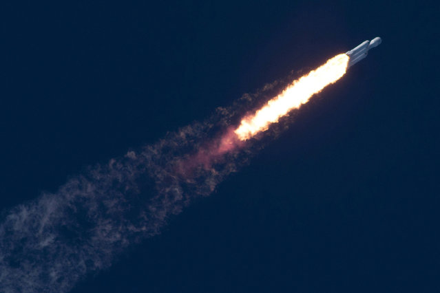 A SpaceX Falcon Heavy rocket climbs towards space after lifting off from historic launch pad 39-A at the Kennedy Space Center in Cape Canaveral, Florida, U.S., February 6, 2018. (Photo by SpaceX/Handout via Reuters)