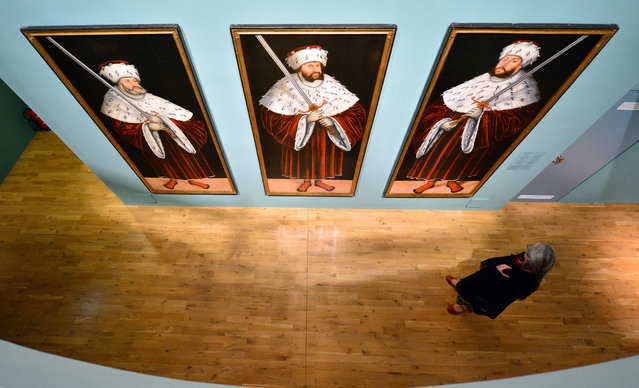 """A woman looks at the paintings """"Frederick the Wise"""" (L-R), """"John the Constant"""", and """"John the Magnanimous"""" by Lucas Cranach the Elder at the exhibition 'Cranach in Weimar' in the Schiller Museum in Weimar, Germany, May 7, 2015. The exhibition has been open from 03 April and can be seen until 14 June. (Photo by Martin Schutt/EPA)"""