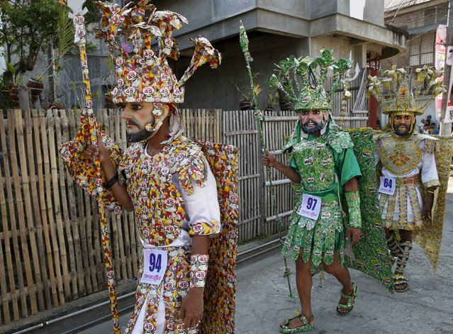 """Penitents known locally as """"Morions"""" wear costumes made of coffee and chocolate Milo drink packaging as they parade during the start of Holy Week celebrations in Mogpog, Marinduque in central Philippines March 21, 2016. (Photo by Erik De Castro/Reuters)"""