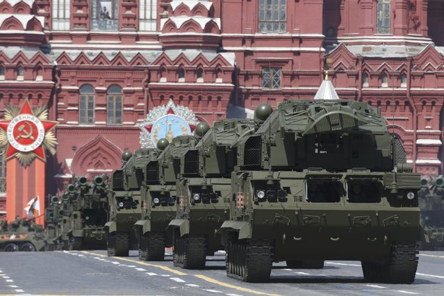 Russian TOR-M2U tactical surface-to-air missile systems drive during the Victory Day parade at Red Square in Moscow, Russia, May 9, 2015. (Photo by Sergei Karpukhin/Reuters)