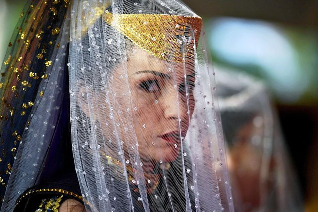 A nymph, a female devotees of the Vale do Amanhecer religious community, prays during their biggest ceremony of the year at their temple complex in Vale do Amanhecer (Sunrise Valley), a community on the outskirts of Planaltina, 50 km from the Brazilian capital, Brasilia, on May 1, 2019. This eclectic community holds its most important ritual of the year on Labour Day to honour the mediums who communicate with good and bad spirits. The group combines a range of religious practices, including Christian and Hindu, with symbols borrowed from the Incas and Mayans, as well as a belief in extraterrestrial life and intergalactic travel. With some 600 temples throughout Brazil, Portugal, Germany, Japan, Bolivia, Uruguay and the United States, the religious movement claims to have 800,000 members. (Photo by Carl De Souza/AFP Photo)