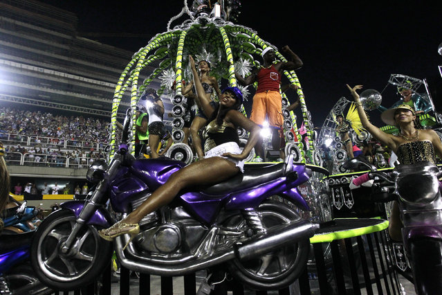 Performers from the Sao Clemente samba school parade during carnival celebrations at the Sambadrome in Rio de Janeiro, Brazil, Monday, March 3, 2014. (Photo by Silvia Izquierdo/AP Photo)
