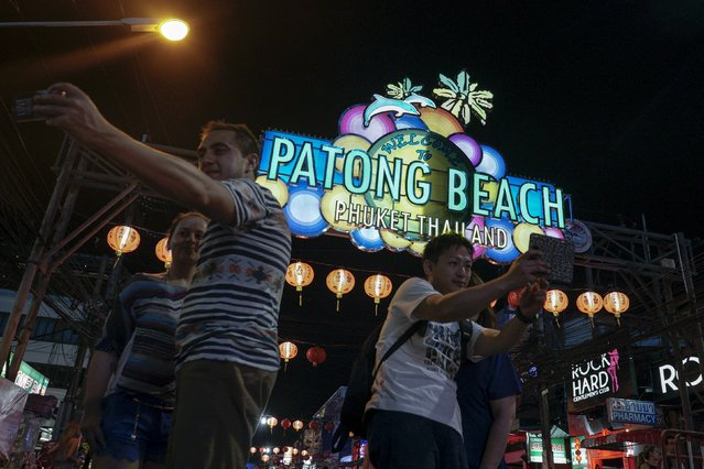 Tourists take selfie on a street near Patong beach in Phuket, Thailand March 19, 2016. (Photo by Athit Perawongmetha/Reuters)