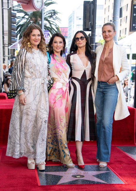 Actress Drew Barrymore (L), Lucy Liu (CL), Demi Moore (CR) and Cameron Diaz (R) stand on the star during Liu's Walk of Fame ceremony in Hollywood on May 1, 2019. Lucy Liu's star is the 2,662nd star on the Hollywood Walk Of Fame in the Category of Television. (Photo by Valerie Macon/AFP Photo)