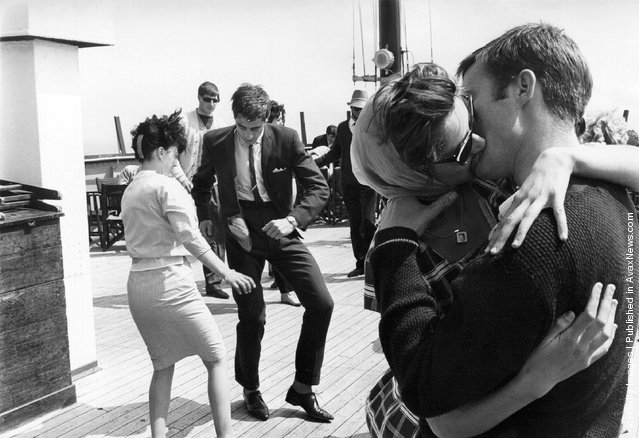 1962: One couple dance the Twist as another kiss on board the steamer the Royal Daffodil during a special cross-Channel trip, with ten bands on board providing music for twelve hours of constant twisting