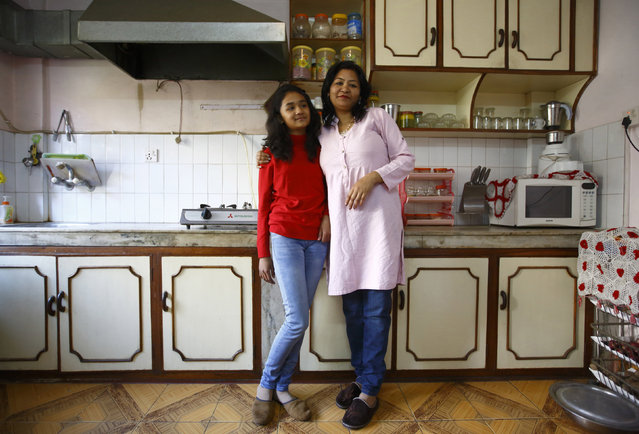 Mohanna Khanal, 35, and her daughter Vipassna Khanal, 12, pose for a photograph in the kitchen of their apartment in Kathmandu February 4, 2014. Mohanna is a school teacher who finished her education when she was 20 years old. Mohanna says that when she was a child, she wanted to become a flight attendant. She hopes that her daughter will become a renowned media personality. Vipassna says that she will finish her education in 2025 and she wants to become a travel agent to promote tourism in Nepal. (Photo by Navesh Chitrakar/Reuters)