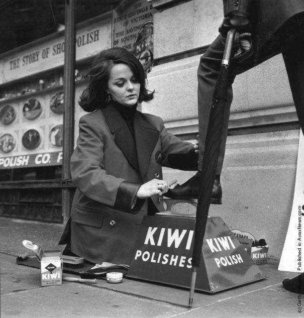 A female bootblack working in the Strand, London