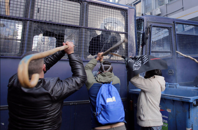 Protesters with shepherds crooks attack a police bus outside the Greek Agriculture Ministry on March 8, 2017 in Athens, Greece. (Photo by Milos Bicanski/Getty Images)