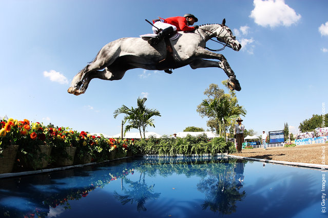 Kent Farrington of the United States makes a jump during the Jumping Competition at the Guadalajara Country Club